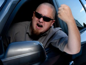Mr. Naquin, pictured above, angered by a column of vehicles occupying the middle lane of MLK.