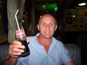 man drinking coke
